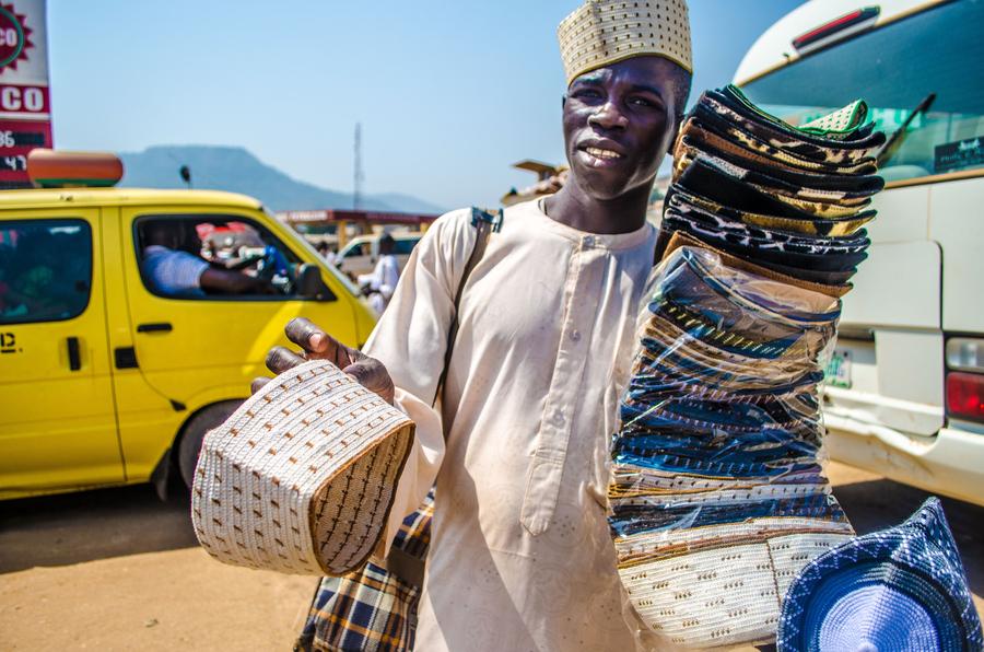 A vendor selling Hausa native caps in Lokoja, Nigeria