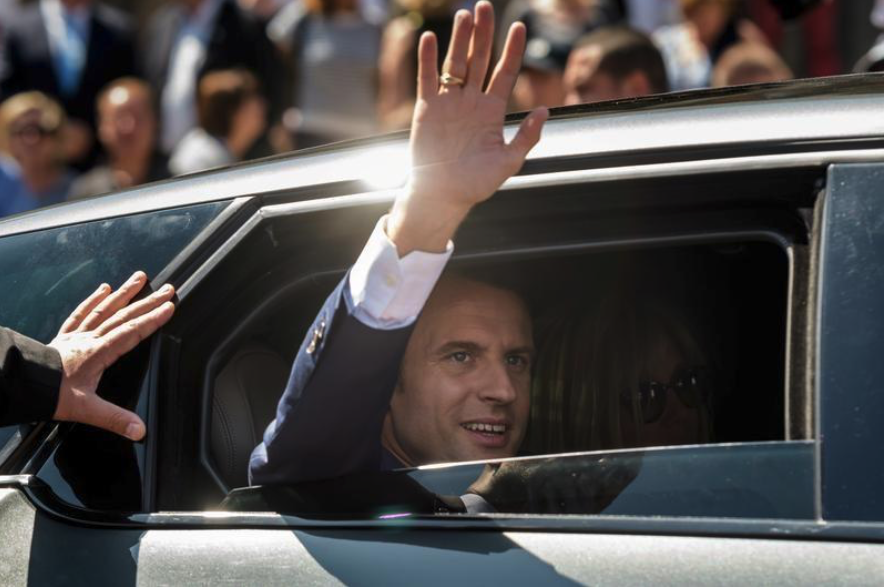 Emmanuel Macron, French President leaves the polling station after voting in the first of two rounds of parliamentary elections in Le Touquet, France, June 11, 2017.