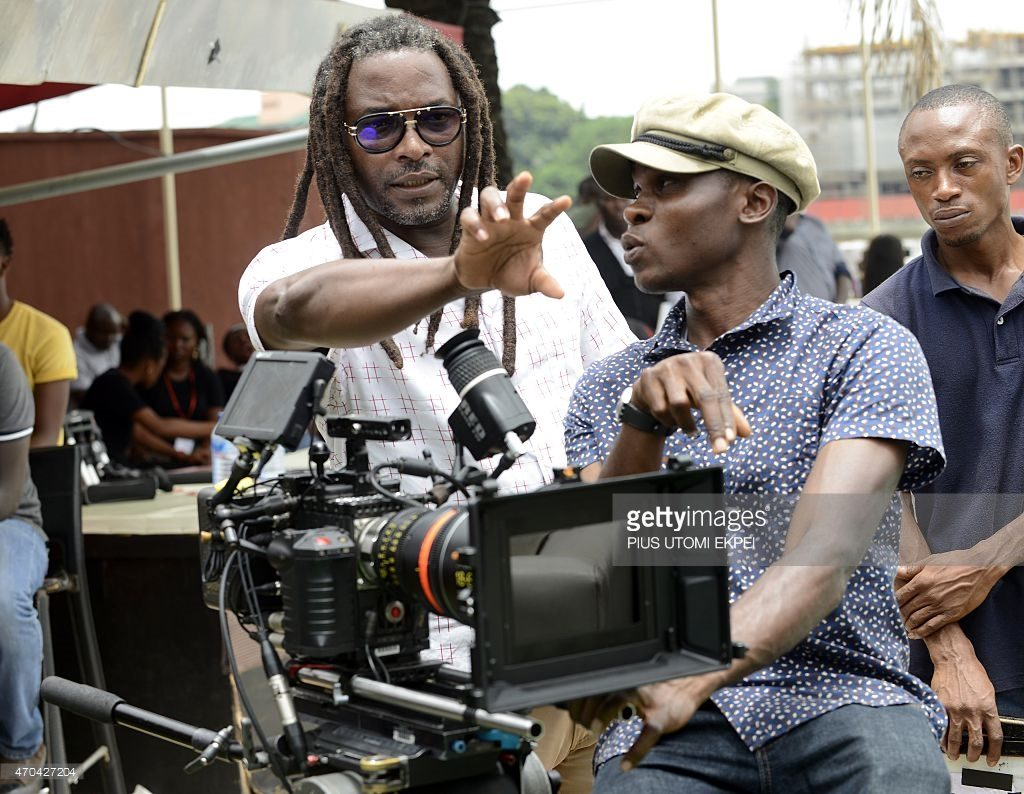 Film director Biyi Bandele speaks to the cameraman during the production MTV Shuga episode 4 Television series in Lagos on April 13, 2015.