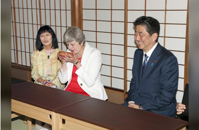 Theresa May, British Prime Minister (2nd L) takes part in a tea ceremony with Shinzo Abe, Japanese Prime Minister (R) at Omotesenke Fushin'an in Kyoto, western Japan August 30, 2017