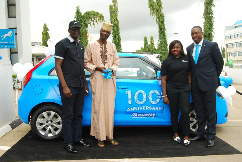 Alu, a customer from Minna receiving his car gift