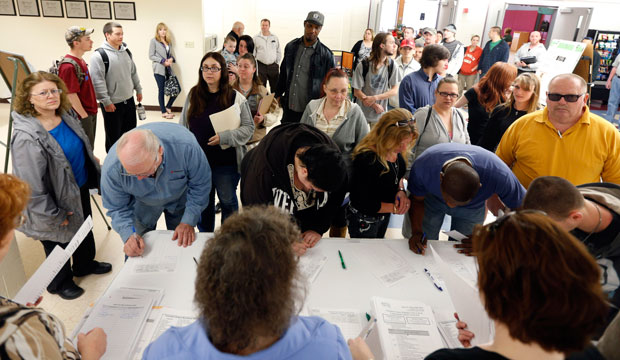 Jobseekers line up for a job fair at Columbia-Greene Community College in Hudson,