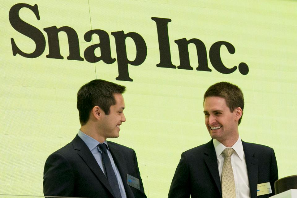 Snap co-founders Bobby Murphy, left, and CEO Evan Spiegel ring the opening bell at the New York Stock Exchange as the company celebrates its IPO.