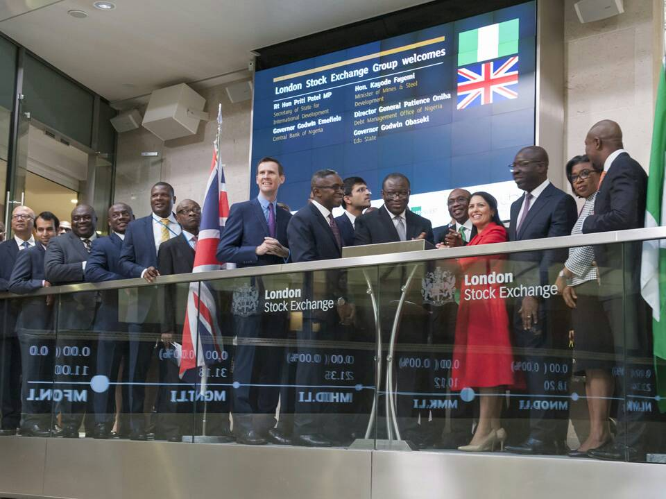 Nigeria's central bank governor, Godwin Emefiele, surrounded by officials, analysts and investors, rings the opening bell, Friday 27th October, 2017 at the London Stock Exchange in the United Kingdom