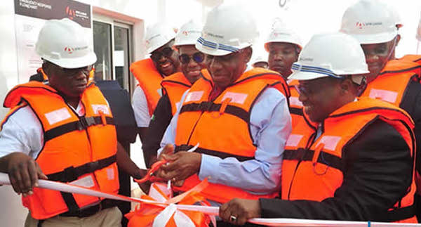 Rotimi Amaechi, Nigeria's minister of transport and Maikanti Baru, group managing director of the NNPC, while opening the Lagos Midstream Jetty (LMJ) at the Apapa Harbour in Lagos.