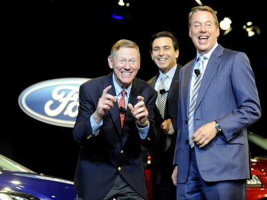 Retiring Ford Motor CEO Alan Mulally makes a picture-taking gesture while clowning around with the company's new CEO Mark Fields, center, and Ford executive chairman Bill Ford Jr. at the Ford World Headquarters in Dearborn on May 1. (Photo: David Coates / The Detroit News)