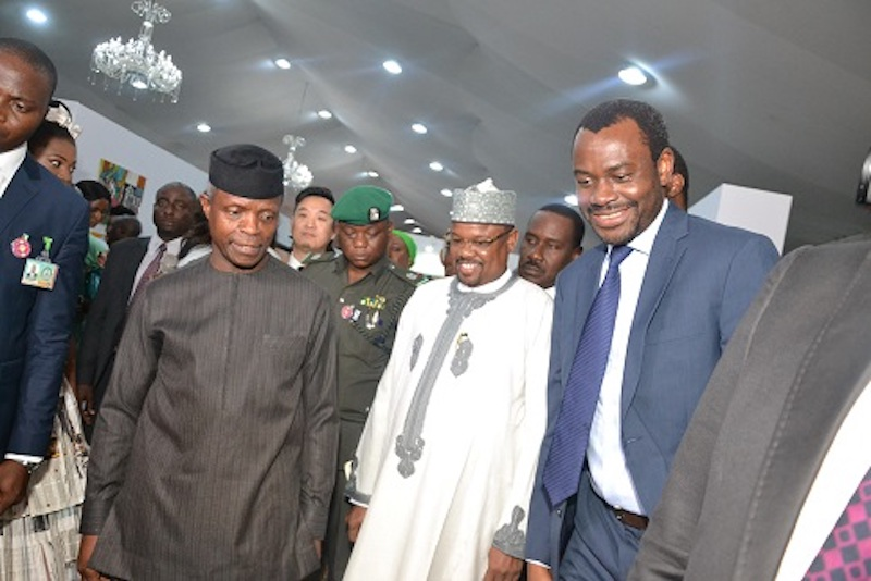 Abubakar Suleiman, then as Executive Director, Sterling Bank Plc., with Yemi Osinbajo, Nigeria's Vice President and Managing Director/CEO, Federal Housing Authority, Mohammed Al-Amin, during an exhibition by the International Federation of Interior Architects/Designers, sponsored by Sterling Bank, in Lagos