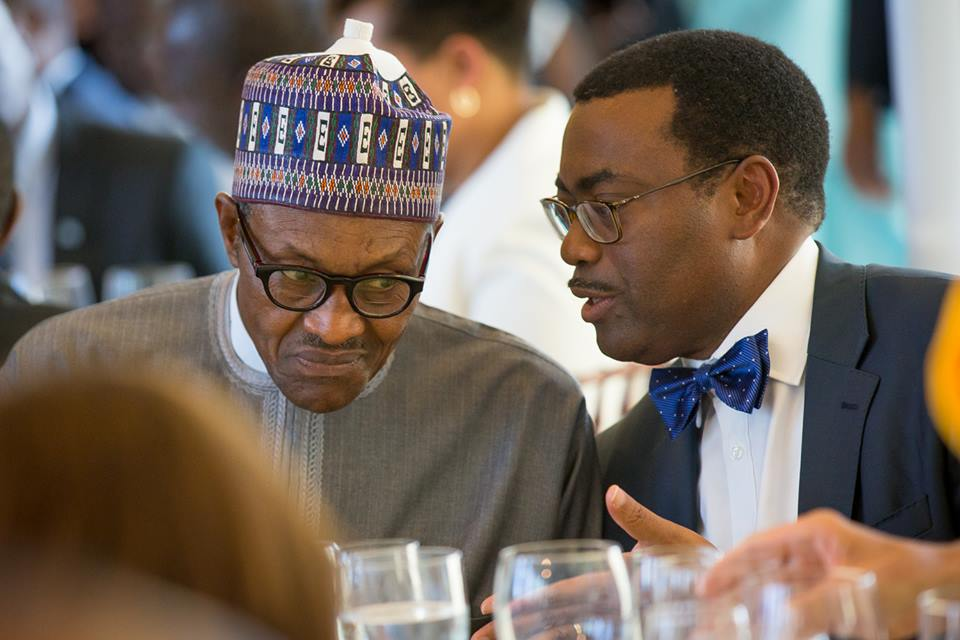 Muhammadu Buhari, Nigeria's president, and Akinwumi Adesina, the president of African Development Bank