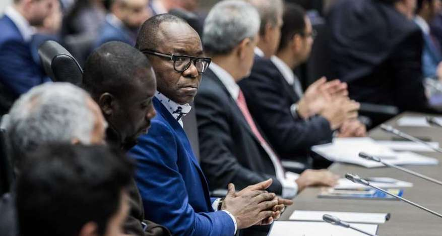 Emmanuel Ibe Kachikwu, Nigeria's petroleum and resources minister, center, looks on during a news conference the 173rd Organization of Petroleum Exporting Countries (OPEC) meeting in Vienna, Austria, on Wednesday, Nov. 29, 2017. OPEC and Russia are said to have agreed they should extend oil-supply cuts deeper into next year, but Moscow wants clarity on an exit strategy before giving formal consent.