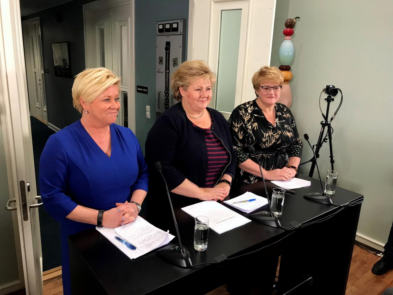 Erna Solberg, Norwegian Prime Minister of the Conservative Party (C), Siv Jensen, Finance Minister of the Progress Party (L) and Trine Skei Grande, Liberal Party leader announce an expansion of the government in Moss, Norway, January 14, 2018. REUTERS/Joachim Dagenborg