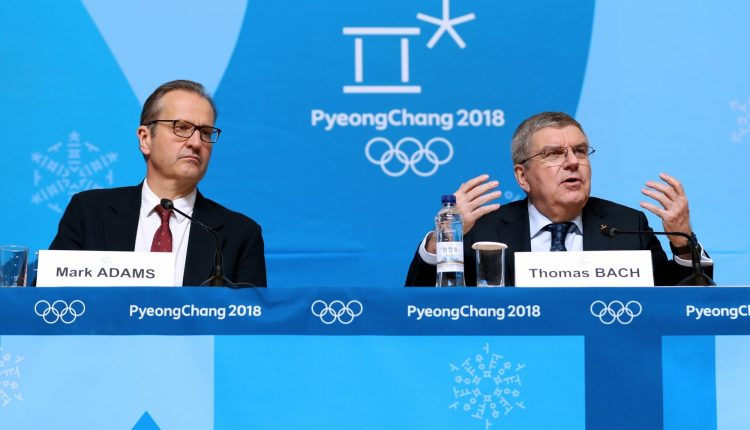 International Olympic Committee president Thomas Bach (R) addresses during a press conference held at Main Press Centre of 2018