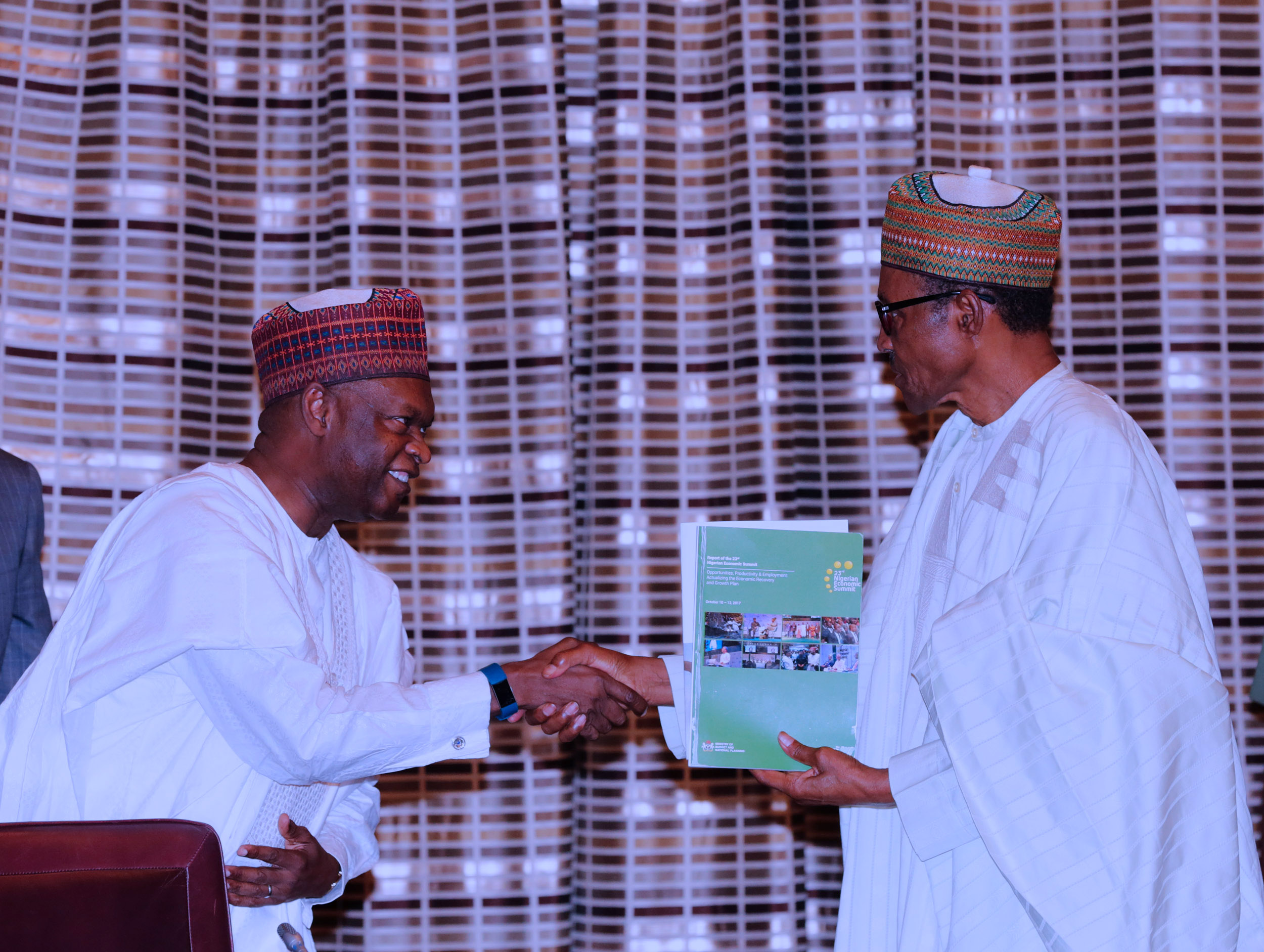 President Muhammadu Buhari receives NESG working document from Kyari Bukar, the Chairman Nigerian Economic Summit Group, NESG, during a courtesy visit by the Board and Management of the Nigeria Economic Summit Group (NESG) at the State House in Abuja. PHOTO; SUNDAY AGHAEZE. JAN 22 2018