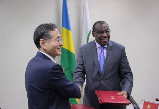 Claver Gatete, Rwanda's minister of finance and economic planning and RAO Hongwei, Chinese ambassador to Rwanda