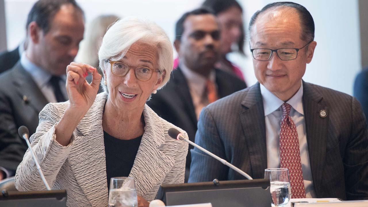 Christine Lagarde, International Monetary Fund (IMF) Managing Director speaks as World Bank President Jim Yong Kim listens at the Carbon Pricing Leadership