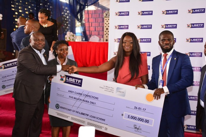 Akinwunmi Ambode, Lagos State Governor, presenting cheques worth over N1billion to about 705 beneficiaries of the Lagos State Employment Trust Fund (ETF) pilot scheme.