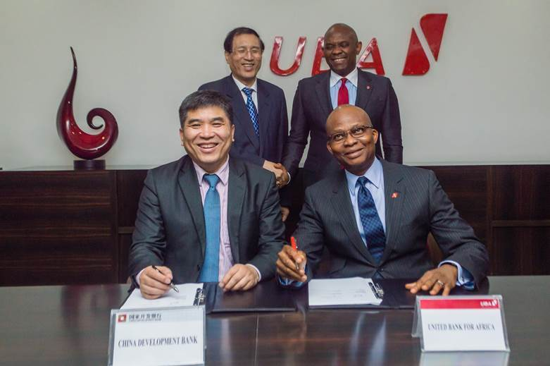 Sitting from Left: Jin Tao, Director General, Global Cooperation Department – Americas and Africa, China Development Bank (CDB); and Kennedy Uzoka GMD/CEO UBA Plc, signing a $100 million loan facility agreement to fund SMEs in Africa. Standing behind are Zheng Zhijie, President of CDB; and Tony Elumelu, Chairman of UBA Plc, at the UBA House in Lagos on Tuesday