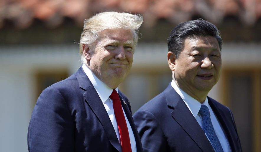 President Donald Trump and Chinese President Xi Jinping walk together after a meeting