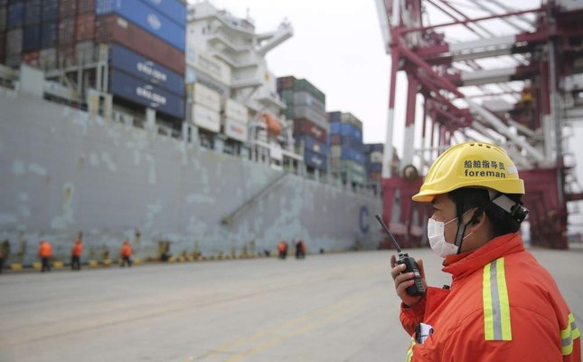 China to halve tariffs on some US imports as virus risks grow