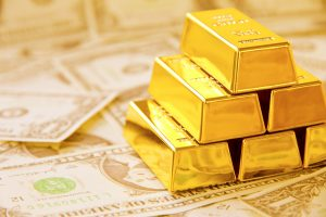 Gold stumbles, loses safe-haven appeal as investors flock to dollar