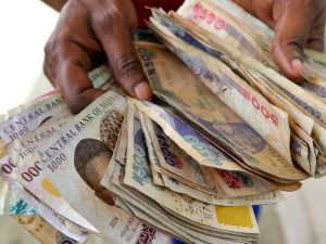 Naira weakens on street, FX reserves climb to $35.7bn in first trading week on optimism